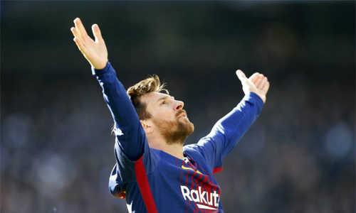 CĐV Real gọi Messi là 'đồ thiểu năng'