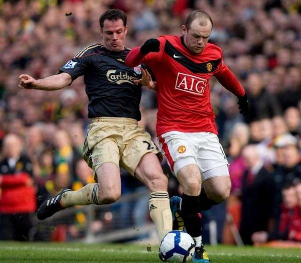 """Rooney và Carragher vốn chẳng """"ưa"""" gì nhau."""